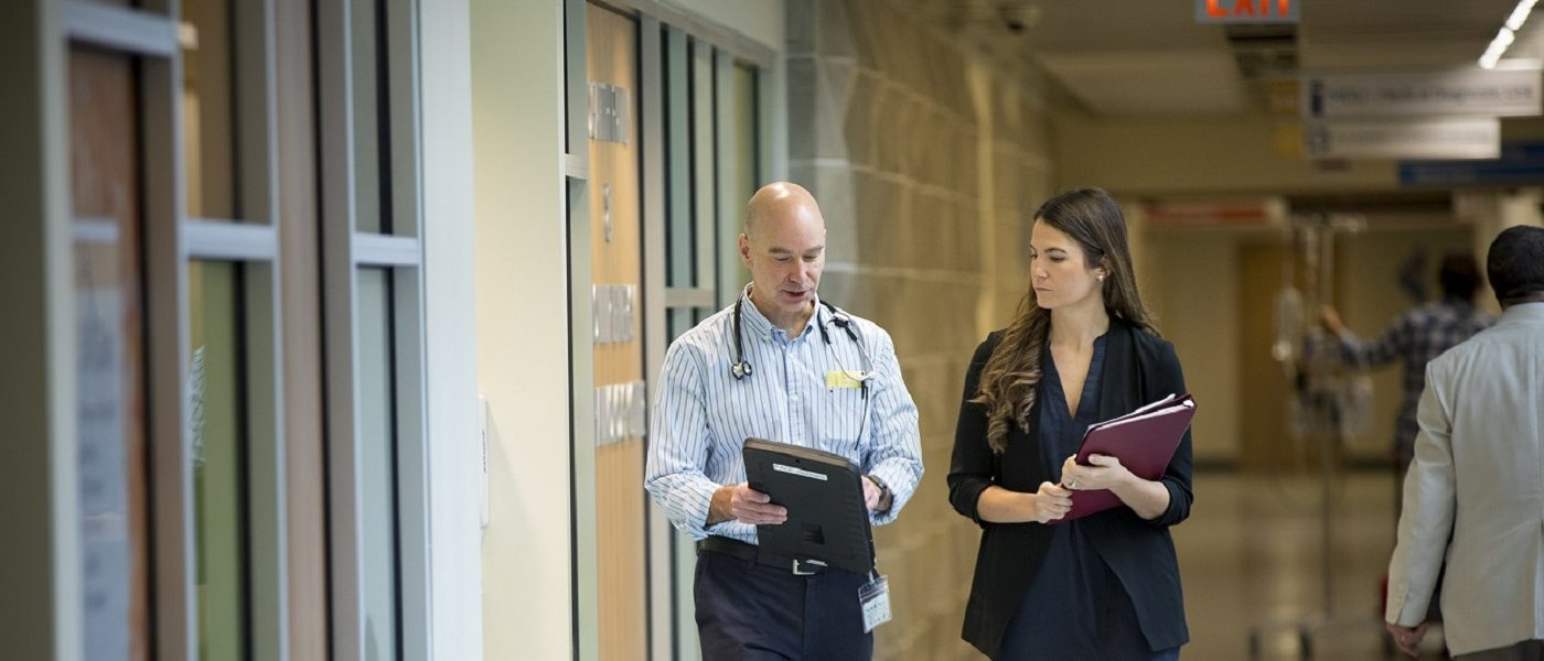 male and female docs hallway